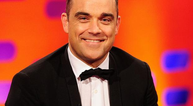 Robbie Williams has had work done on his hair