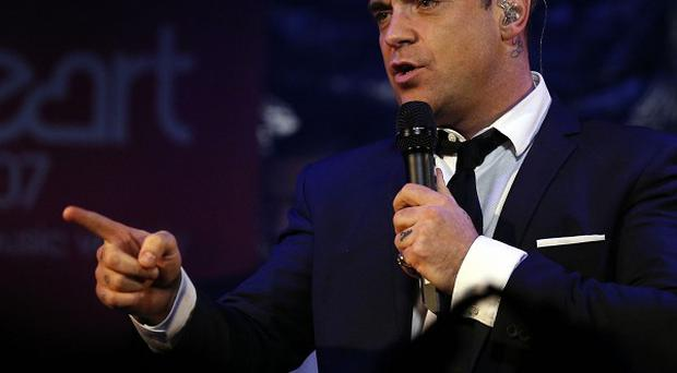 Robbie Williams is celebrating chart success with his latest album