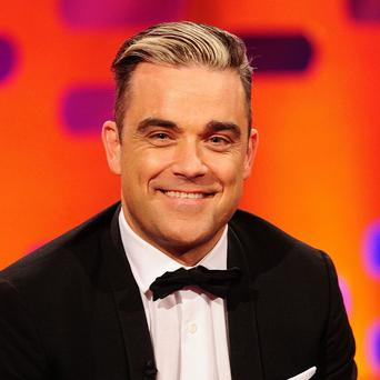 Robbie Williams has bought a mansion that previously belonged to the late Michael Winner, according to reports