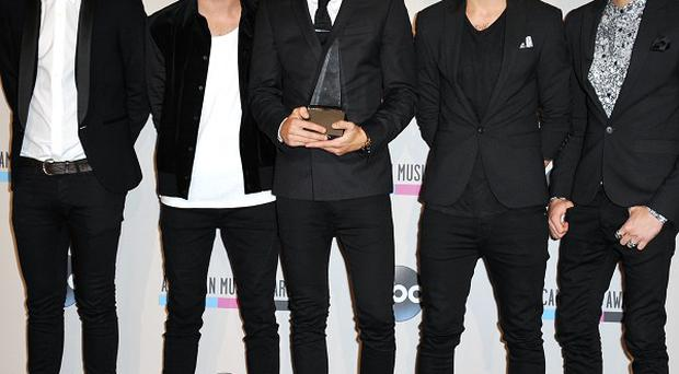One Direction's calendar has topped the latest best-seller list