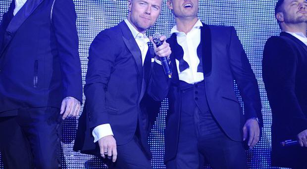 Boyzone have revealed they prefer tea and hugs over the rock and roll lifestyle