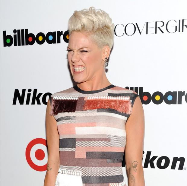 Singer Pink, the Woman of the Year honoree, arrives at the Billboard Women In Music Awards at Capitale on Tuesday, Dec. 10, 2013 in New York. (Photo by Evan Agostini/Invision/AP)