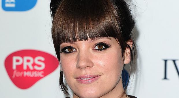 Lily Allen held on to her place at the top of the singles charts