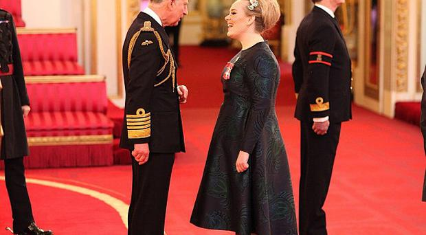 Adele is made an MBE for services to music by the Prince of Wales