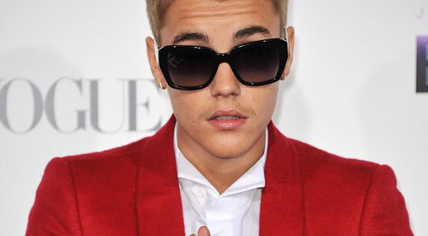 Justin Bieber arrives at the world premiere of Justin Bieber's Believe in Los Angeles