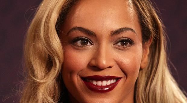 Beyonce's self-titled fifth album debuted at No 1 on the Billboard charts