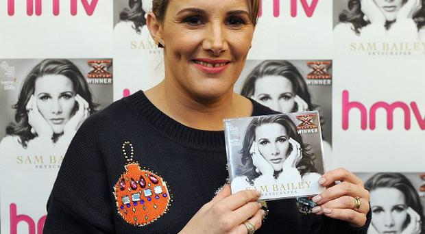 X Factor winner Sam Bailey with a copy of her Christmas number one single