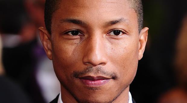 Pharrell Williams scored his third UK number one single with Happy