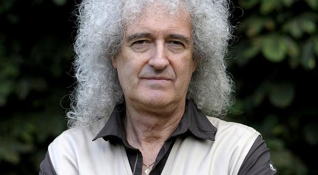 Brian May celebrated getting good news from his doctor with a cup of tea