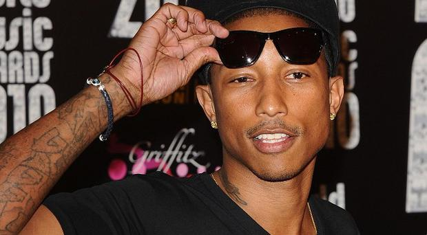 Pharrell Williams looks set to keep his spot at the top of the charts