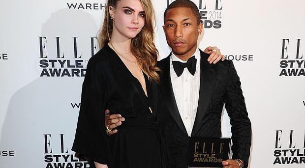Cara Delevingne and Pharrell Williams are considering a musical collaboration