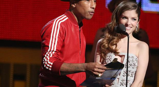 Pharrell Williams - with hat - and Anna Kendrick present the award for best new artist at the Grammy Awards in Los Angeles (AP)