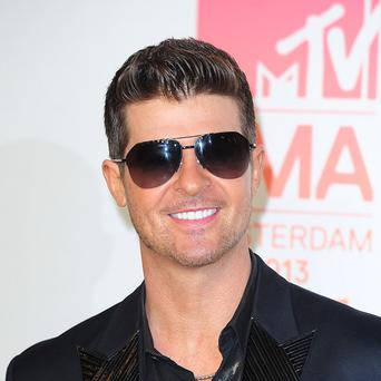 Robin Thicke says he's hoping to sort things out with his wife