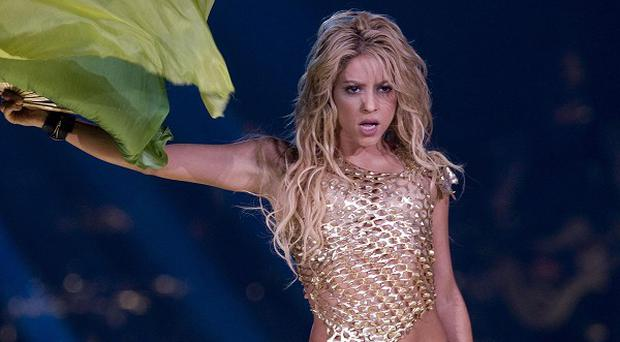 Shakira performing on stage at the O2 arena