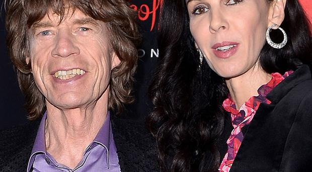 Sir Mick Jagger with girlfriend L'Wren Scott, who has been found dead