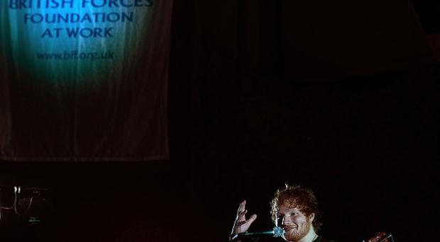 Ed Sheeran performing to British troops at Camp Bastion at the weekend, where he played two gigs supported by comedian Craig Campbell, he met troops going about their duties in Britain's desert base.