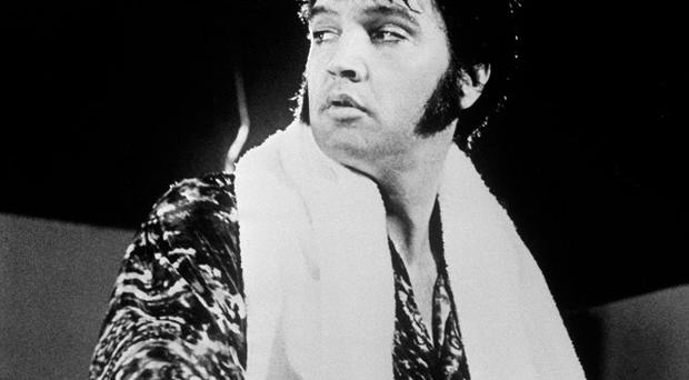 A strand of Elvis Presley's hair is going under the hammer