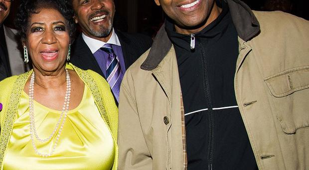 Aretha Franklin and Denzel Washington at her 72nd birthday celebration in New York (AP)
