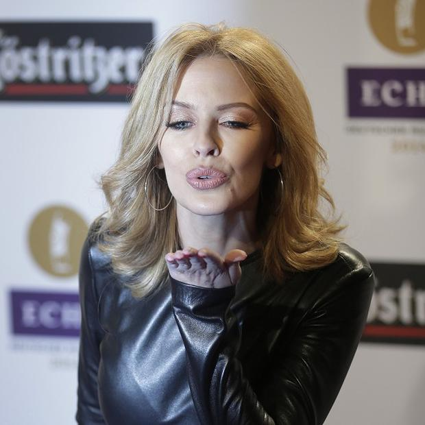 Kylie Minogue blows a kiss as she arrives for the Echo 2014 music awards show in Berlin
