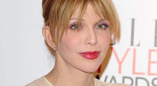 Courtney Love has reunited with her former Hole bandmates