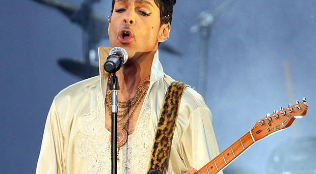Prince has won a legal battle with Warner Bros