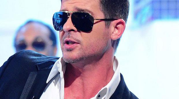 Robin Thicke's Blurred Lines has been named most downloaded tune in the UK