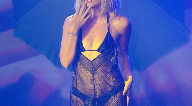 Lily Allen performs at G-A-Y in London (Rex)