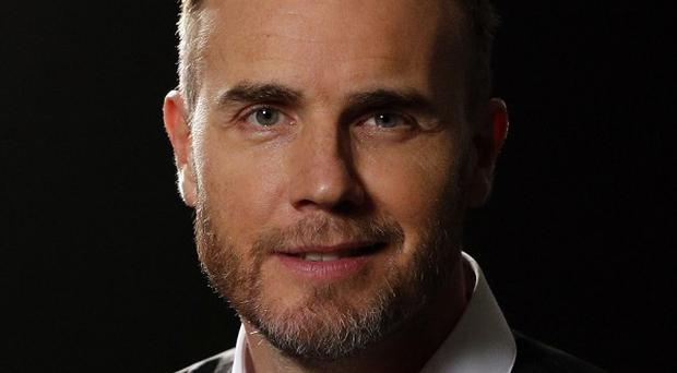 Gary Barlow sent out topless pictures of himself to get noticed