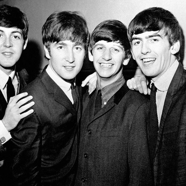 A guitar owned by Beatle George Harrison is going under the hammer