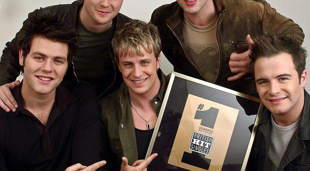 Kian Egan challenged pop mogul Simon Cowell over claims Westlife were
