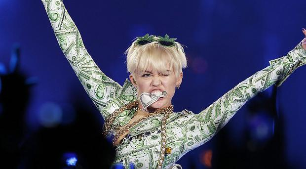 Miley Cyrus has denied that she was referring to her ex on stage at G-A-Y