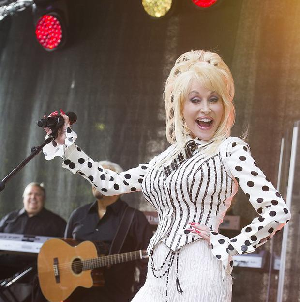 Dolly Parton has stood up or her goddaughter Miley Cyrus