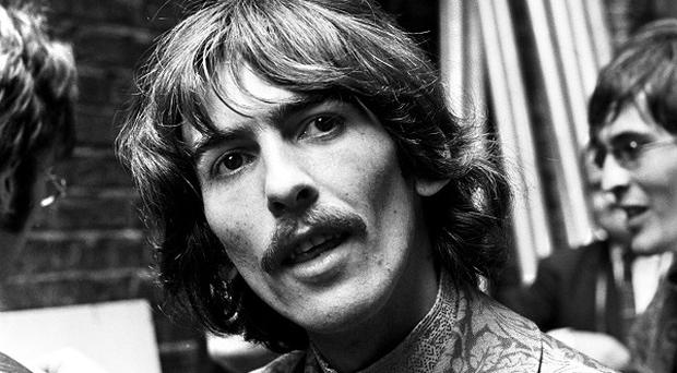 George Harrison's guitar has sold at auction for 657,000 US dollars