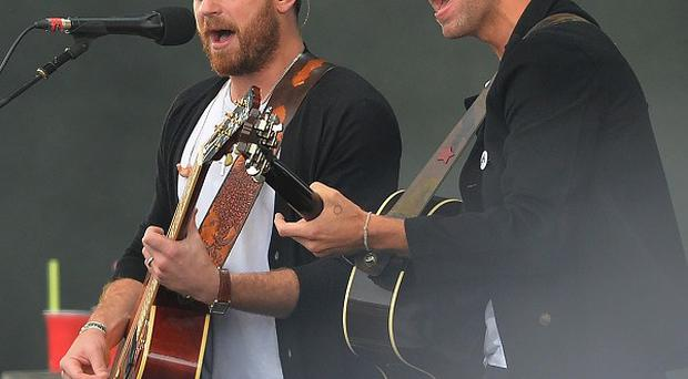 The Kings of Leon with Chris Martin performing during Radio 1's Big Weekend at Glasgow Green