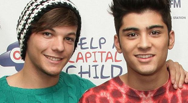 One Direction members Louis Tomlinson and Zayn Malik are reportedly heard joking about