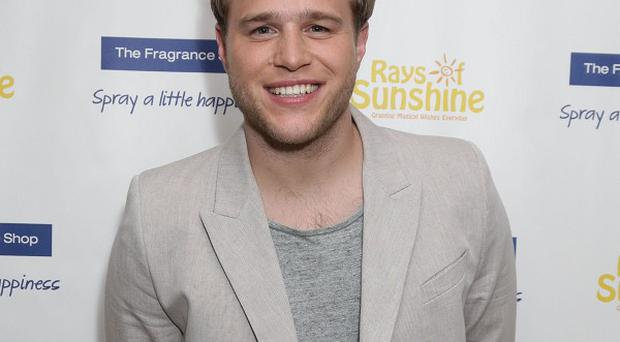 Olly Murs who has been unveiled as the most played pop star of 2013