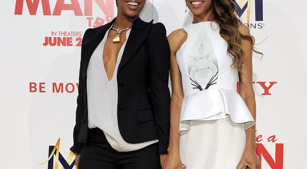 Destiny's Child singers Kelly Rowland and Michelle Williams reunited with Beyonce for a new track