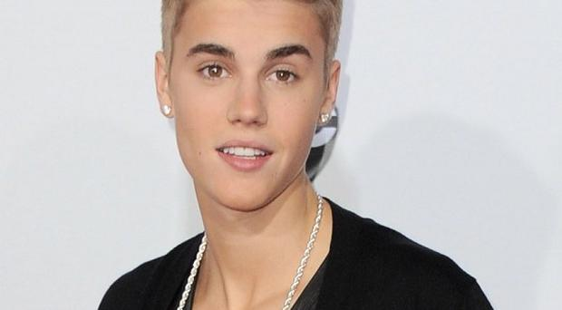 Justin Bieber will not be charged in relation to an alleged tussle with a woman over a cellphone