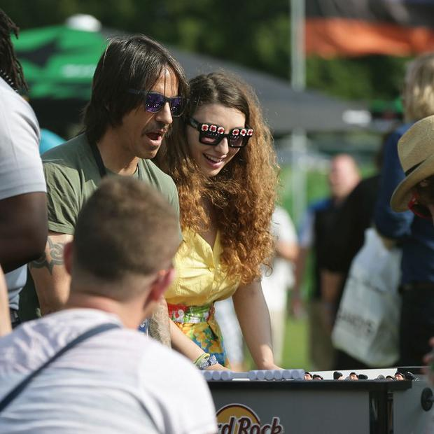 Anthony Kiedis of the Red Hot Chili Peppers playing table football backstage at the Isle of Wight Festival