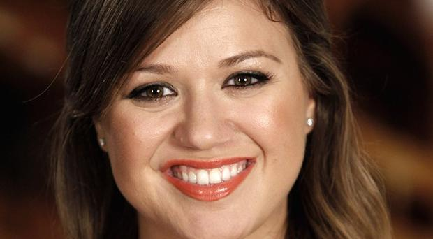 Kelly Clarkson has announced the birth of her daughter in a post on Twitter (AP)