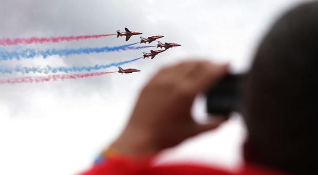 The Red Arrows display team flying above the Isle of Wight Festival