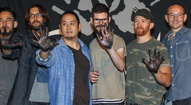Linkin Park have been inducted to the Rock Walk at Guitar Centre on Sunset Boulevard