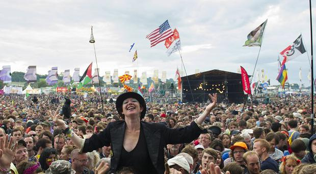 The crowd watch The Pixies perform at the Glastonbury Festival