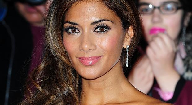 Nicole Scherzinger has spoken about her battle with an eating disorder