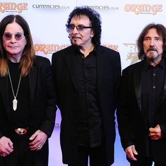 Ozzy Osbourne, Tony Iommi and Geezer Butler of Black Sabbath