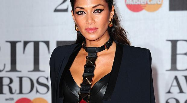 Nicole Scherzinger says she wishes she could share in One Direction's success