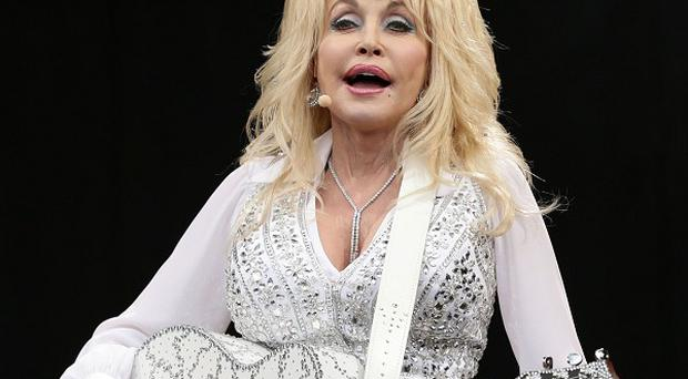Dolly Parton is relieved the dog left behind at Glastonbury has been claimed by its owners