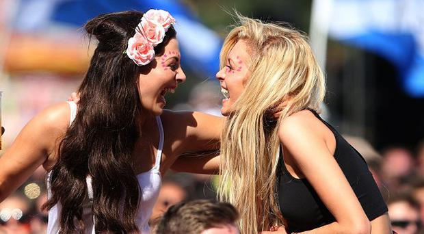 Festivalgoers enjoy themselves in the crowd at T in the Park music festival held at Balado Park in Kinross, Scotland