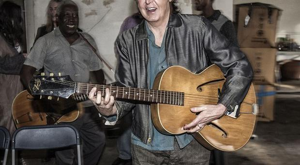 Sir Paul McCartney's first-ever guitar makes an appearance in the Early Days video