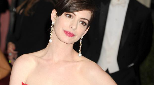 Anne Hathaway dresses as a dude for a new music video